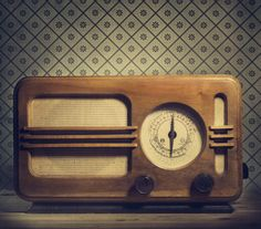 Antique radio on retro background